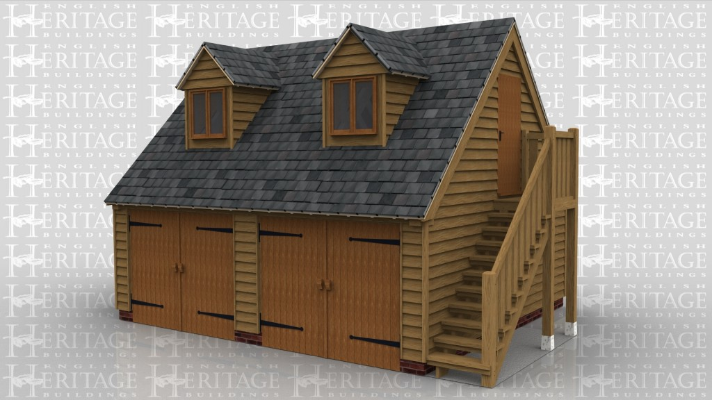 A 2 bay garage with upper floor and side store/entrance. The side store/entrance has oak weatherboarding and a slate roof, there is a solid single iroko door at the front. The main garage frame also has oak weatherboarding and a slate roof and at the front on the geround floor there is a pair of iroko garage doors at the front of each bay and on the right hand side is an external oak staircase allowing access to the first floor. On the first floor there is a solid single door on the right and at the front are 2 dormers each containing a 2 light window.