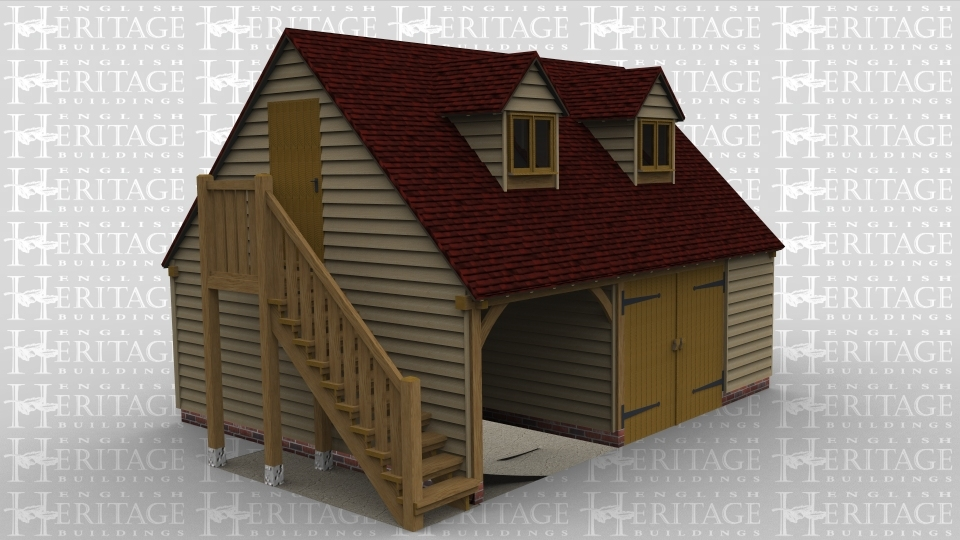 A 2 bay oak framed garage with upper floor. On the ground floor one bay is left open at the front while the second bay is enclosed with a pair of iroko garage doors. The left of the building has an external staircase leading to the first floor. On the first floor is a solid single door on the left of the building and at the front are 2 dormer windows housing a 2 light window in each.