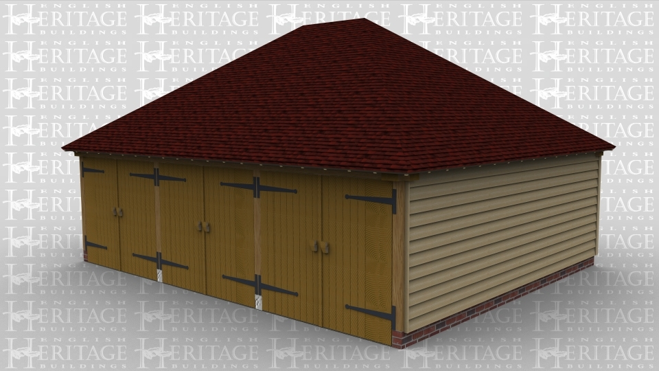 A 3 bay oak framed garage with 3 pairs of iroko garage doors at the front with a full hip roof on both ends.