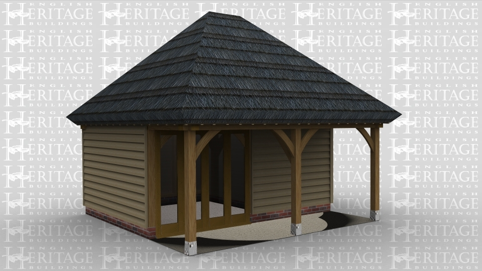A 2 bay oak framed building with a thatch roof and a set back partition at the front to create a walkway. The front wall has a 4 pane section of full height glazing to allow the natural light into the frame.
