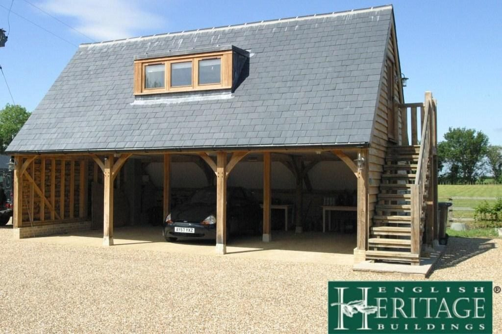 three bay oak framed garage with rooms above