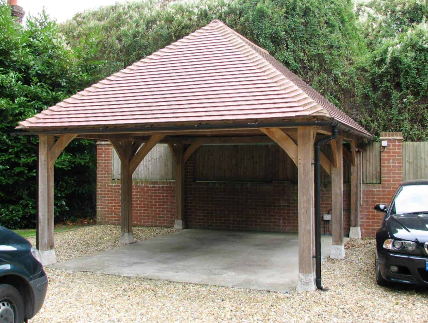 An oak carport at a shaded country property